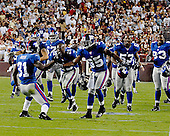 Landover, MD - September 23, 2007 -- New York Giants celebrate after their defense held on the goal line late in the fourth quarter giving them their first victory of the season against the Washington Redskins at FedEx Field in Landover, MD on Sunday, September 23, 2007.  The Giants won the game 24 - 17..Credit: Ron Sachs / CNP.(RESTRICTION: NO New York or New Jersey Newspapers or newspapers within a 75 mile radius of New York City)