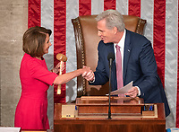 Speaker of the United States House of Representatives Nancy Pelosi (Democrat of California), left, shakes hands with US House Minority Leader Kevin McCarthy (Republican of California), right, after he handed the gavel to her as the 116th Congress convenes for its opening session in the US House Chamber of the US Capitol in Washington, DC on Thursday, January 3, 2019. Photo Credit: Ron Sachs/CNP/AdMedia