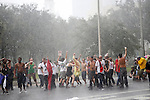 Protesters continue to dance and march in the streets despit the rain from Tropical Storm Isaac during the 2012 Republican National Convention on August 27, 2012 in Tampa, Fla.