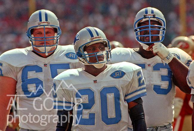 San Francisco 49ers vs. Detroit Lions at Candlestick Park Sunday, October 20, 1991.  49ers beat Lions 35-3.  L-R: Lions Guard Eric Andolsek, running back Barry Sanders, center Kevin Glover (53).