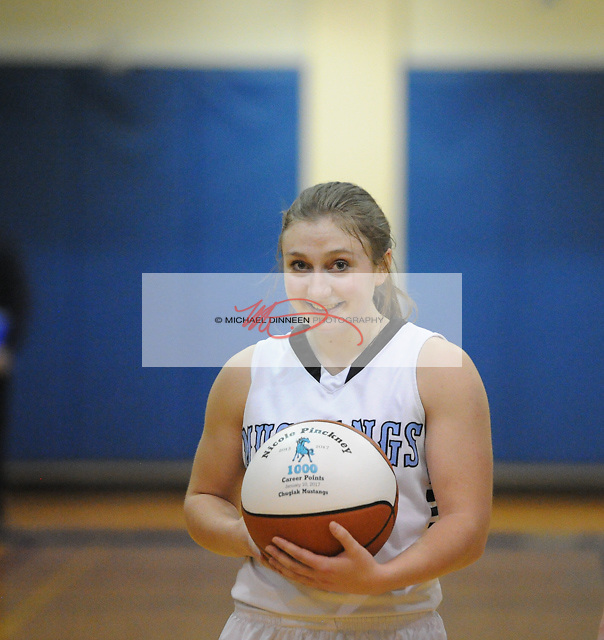 Chugiak's Nicole Pinckney holds a ball celebrating her surpassing 1,000 career points Tuesday, Jan. 10, 2017.  Photo for the Star by Michael Dinneen