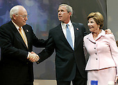 United States President George W. Bush (M) hugs his wife Laura as he shakes hands with Vice President Dick Cheney after delivering  his victory speech during an event at the Ronald Reagan Building, November 3, 2004 in Washington DC. After deciding not to contest the votes in the battleground state of Ohio, Democratic presidential candidate Sen. John Kerry (Democrat of Massachusetts) called President Bush to concede and congratulated him.     <br /> Credit: Mark Wilson / Pool via CNP