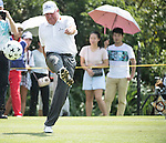 Mark O'Meara kicks a football during the World Celebrity Pro-Am 2016 Mission Hills China Golf Tournament on 23 October 2016, in Haikou, Hainan province, China. Photo by Weixiang Lim / Power Sport Images