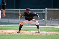 GCL Marlins first baseman Omar Lebron (30) stretches for a throw during a Gulf Coast League game against the GCL Astros on August 8, 2019 at the Roger Dean Chevrolet Stadium Complex in Jupiter, Florida.  GCL Marlins defeated GCL Astros 5-4.  (Mike Janes/Four Seam Images)