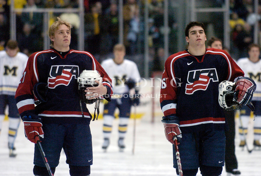 U.S. National Under-18 Team members Jack Johnson (27) and Jason Bailey (16) stand for the playing of the National Anthem before the Wolverines' 6-5 win over the U.S. National Under-18 Team on Saturday, February 26, 2005 at Yost Ice Arena in Ann Arbor, Mich. (Photo by TONY DING/The Michigan Daily)