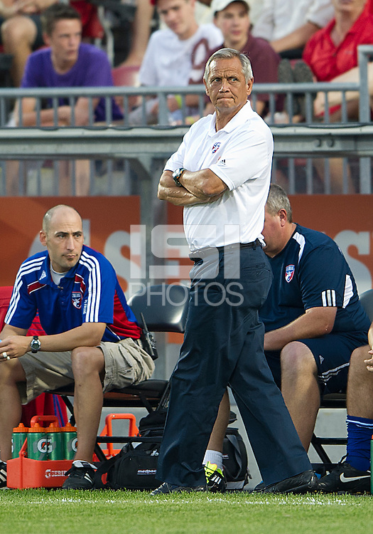 FC Dallas head coach Schellas Hyndman watches the action during an MLS game between the FC Dallas and the Toronto FC at BMO Field in Toronto on July 20, 2011..FC Dallas won 1-0.