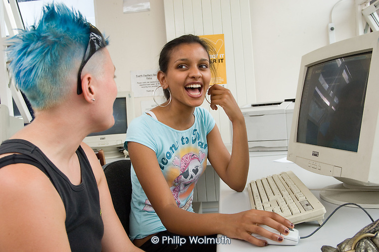 Segen (18) with youth worker Hanna in the computer room at the Fourth Feathers Youth Club, Lisson Green,