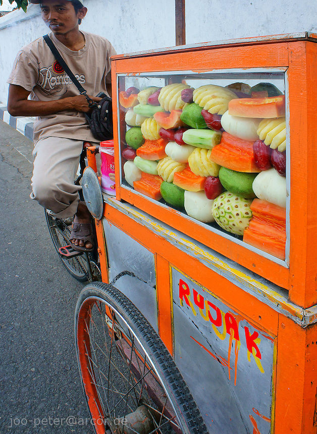 fruit seller in the streets of Yogyakarta, island Java, archipelago of Indonesia,  September 2011