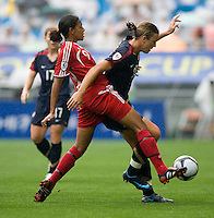 USWNT forward (20) Abby Wambach fights for the ball with Canada's (9) Candace Chapman during the finals of the Peace Queen Cup.  The USWNT defeated Canada, 1-0, at Suwon World Cup Stadium in Suwon, South Korea.
