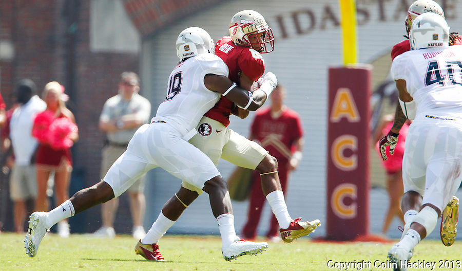 TALLAHASSEE, FLA.10-05-13-FSU-MARY100513CH-Florida State's Kenny Shaw is wrapped up by Maryland's A.J. Hendy during first half action Saturday at Doak Campbell Stadium in Tallahassee. <br /> COLIN HACKLEY PHOTO