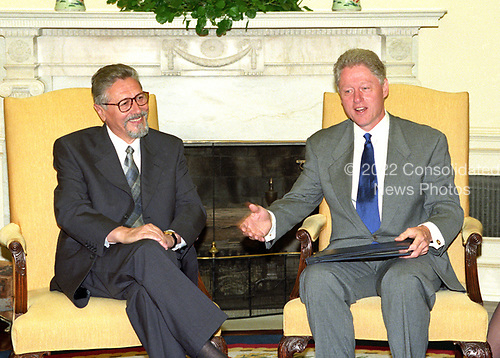 United States President Bill Clinton hosts a working visit with President Emil Constantinescu of Romania in the Oval Office of the White House in Washington, DC on Thursday, July 16, 1998.<br /> Credit: Ron Sachs / CNP