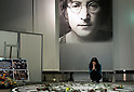 SAITAMA - DEC. 5: A Japanese woman pays her tribute at the memorial set up each year at the John Lennon Museum in Saitama, Tokyo, on the anniversary of the assasination of John Lennon: December 8th, 1980.  (Photo by Alfie Goodrich/Nippon News)