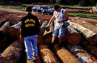 Brazil,Ananindeua : 06/12/99  - Federal pololice agent and Greenpeace´s  activist during operation against the Amazonian rainforest, the world's largest, is under siege from illegal loggers who export its hard woods to Japan at EIDAI of  BRAZIL in Ananindeua city near Belém northern Brazil.