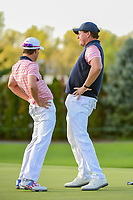 Phil Mickelson (USA) and Kevin Kisner (USA) do a little celebration dance after Phil sunk his birdie putt on 18 to win the match during round 2 Four-Ball of the 2017 President's Cup, Liberty National Golf Club, Jersey City, New Jersey, USA. 9/29/2017.<br /> Picture: Golffile | Ken Murray<br /> <br /> All photo usage must carry mandatory copyright credit (&copy; Golffile | Ken Murray)