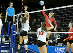 SIOUX FALLS, SD - DECEMBER 8:  Kayce Krucki #5 from Wheeling Jesuit tips the ball past Alexandra Preuss #2 from Lewis during their quarterfinal match at the 2016 Women's Division II Volleyball Championship at the Sanford Pentagon in Sioux Falls, SD. (Photo by Dave Eggen/Inertia)