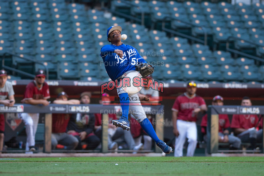 Kansas City Royals third baseman Dennicher Carrasco (51) makes a throw to first base during an Instructional League game against the Arizona Diamondbacks at Chase Field on October 14, 2017 in Scottsdale, Arizona. (Zachary Lucy/Four Seam Images)