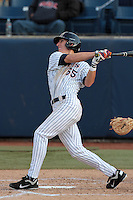 Michael Lorenzen #55 of the Cal State Fullerton Titans bats against the Loyola Marymount Lions at Goodwin Field on February 29, 2012 in Fullerton,California. Cal State Fullerton defeated LMU 6-2.(Larry Goren/Four Seam Images)