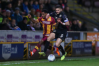 Tyrell Robinson of Bradford City and Samy Morsy of Wigan during the Sky Bet League 1 match between Bradford City and Wigan Athletic at the Northern Commercial Stadium, Bradford, England on 14 March 2018. Photo by Thomas Gadd.