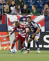 Second half substitute New England Revolution defender Ryan Cochrane (45) defends as FC Dallas midfielder Jackson Goncalves (6) dribbles. In a Major League Soccer (MLS) match, the New England Revolution defeated FC Dallas, 2-0, at Gillette Stadium on September 10, 2011.