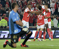 BOGOTÁ -COLOMBIA, 04-05-2014. Jugadores de Independiente Santa Fe celebran un gol en contra del Once Caldas durante partido de vuelta por los cuartos de final de la Liga Postobón  I 2014 jugado en el estadio Nemesio Camacho el Campín de la ciudad de Bogotá./ Independiente Santa Fe players celebrate a goal against Once Caldas during second leg match for the quarterfinals of the Postobon League I 2014 played at Nemesio Camacho El Campin stadium in Bogotá city. Photo: VizzorImage/ Gabriel Aponte / Staff
