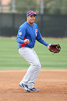 Aramis Ramirez #16 of the Chicago Cubs participates in infield practice during spring training workouts at the Cubs complex on February 19, 2011  in Mesa, Arizona. .Photo by Bill Mitchell / Four Seam Images.