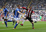 Maikel Kieftenbeld of Birmingham City tussles with John Fleck of Sheffield Utd  during the championship match at St Andrews Stadium, Birmingham. Picture date 21st April 2018. Picture credit should read: Simon Bellis/Sportimage