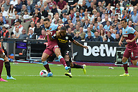 Ryan Fredericks of West Ham United tackles Raheem Sterling of Manchester City during West Ham United vs Manchester City, Premier League Football at The London Stadium on 10th August 2019