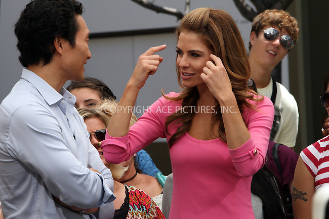 WWW.ACEPIXS.COM . . . . .  ....May 10 2012, LA....Daniel Dae Kim and Maria Menounos at a taping of 'Extra' at The Grove on May 10 2012 in LA.. ..Please byline: Zelig Shaul - ACE PICTURES.... *** ***..Ace Pictures, Inc:  ..Philip Vaughan (212) 243-8787 or (646) 769 0430..e-mail: info@acepixs.com..web: http://www.acepixs.com