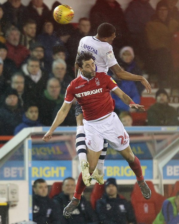 Preston North End's Lukas Nmecha jumps with Nottingham Forest's Claudio Yacob<br /> <br /> Photographer Mick Walker/CameraSport<br /> <br /> The EFL Sky Bet Championship - Nottingham Forest v Preston North End - Saturday 8th December 2018 - The City Ground - Nottingham<br /> <br /> World Copyright © 2018 CameraSport. All rights reserved. 43 Linden Ave. Countesthorpe. Leicester. England. LE8 5PG - Tel: +44 (0) 116 277 4147 - admin@camerasport.com - www.camerasport.com