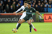(L-R) Kyle Naughton of Swansea City challenges  Raheem Sterling of Manchester City during the Premier League match between Swansea City and Manchester City at The Liberty Stadium, Swansea, Wales, UK. Wednesday 13 December 2017