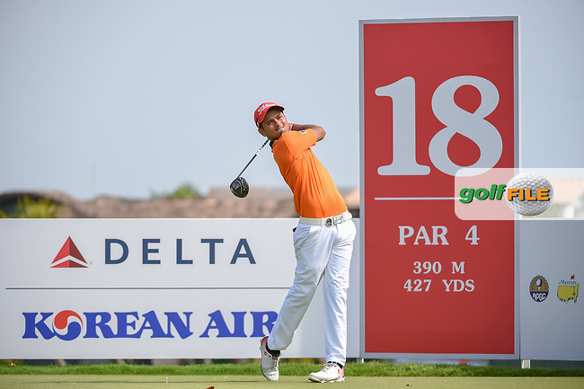 Leon Philip D'SOUZA (HKG) watches his tee shot on 18 during Rd 1 of the Asia-Pacific Amateur Championship, Sentosa Golf Club, Singapore. 10/4/2018.<br /> Picture: Golffile   Ken Murray<br /> <br /> <br /> All photo usage must carry mandatory copyright credit (© Golffile   Ken Murray)