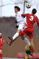 November 16, 2008: Michigan State University's Doug DeMartin (#10) heads the ball past University of Indiana's Stephan Lucianek (#3) during the Championship game of the 2008Big Ten Tournament in Madison Wisconsin.