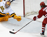 Jinelle Zaugg scores 1 of 4 Badger goals against Minnesota goaltender Brittony Chartier as Wisconsin tops the Gophers 4-1 Friday night, 1/5/07, at Ridder Arena in Minneapolis