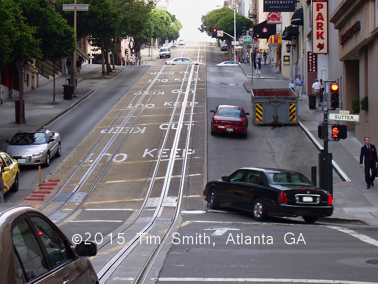 View uphill on Powell Street at Sutter Street in San Francisco.  The tracks show how the Powell St. Trolley runs up this very steep hill.