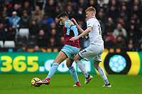 Burnley's Matthew Lowton battles with Swansea City's Sam Clucas<br /> <br /> Photographer Ashley Crowden/CameraSport<br /> <br /> The Premier League - Swansea City v Burnley - Saturday 10th February 2018 - Liberty Stadium - Swansea<br /> <br /> World Copyright &copy; 2018 CameraSport. All rights reserved. 43 Linden Ave. Countesthorpe. Leicester. England. LE8 5PG - Tel: +44 (0) 116 277 4147 - admin@camerasport.com - www.camerasport.com
