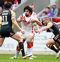 PICTURE BY CHRIS MANGNALL /SWPIX.COM...Rugby League - Super League  - St Helens Saints v Wigan Warriors  - Langtree Park, St Helens, England  - 06/04/12... St Helens Sia Soliola  tackled by  Wigans Harrison Hansen Thomas Leuluai