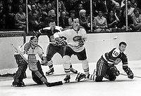 California Golden Seals vs. Montreal Canadiens, goalie Phil Myre, #2 Jacques Laperriere,..Seals Ted Hampson and Earl Ingarfield. (1970 photo/Ron Riesterer)