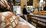 "BRUSSELS - BELGIUM - 27 OCTOBER 2010 --  ?Le Pain Quotidien"" on Place Sablon in Brussels. ?Le Pain Quotidien"" has grown into an international chain of around 200  bakery-restaurants in 16 countries. -- Didier Blondeel serving Onno Brouwer, who with his sons Owen (le) and Jeremy (ri) have visited ?Le Pain Quotidien"" in Amsterdam and New York. -- PHOTO: Juha ROININEN / EUP-Images.-- hsta --"