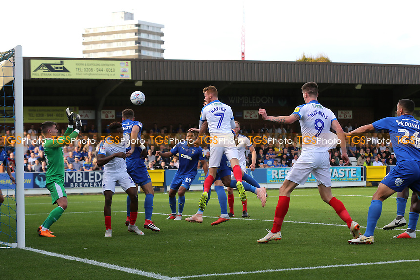 Tom Naylor scores Portsmouth's opening goal with a fine header during AFC Wimbledon vs Portsmouth, Sky Bet EFL League 1 Football at the Cherry Red Records Stadium on 13th October 2018