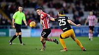 Lincoln City's Shay McCartan vies for possession with Newport County's Mark O'Brien<br /> <br /> Photographer Chris Vaughan/CameraSport<br /> <br /> The EFL Sky Bet League Two - Lincoln City v Newport County - Saturday 22nd December 201 - Sincil Bank - Lincoln<br /> <br /> World Copyright © 2018 CameraSport. All rights reserved. 43 Linden Ave. Countesthorpe. Leicester. England. LE8 5PG - Tel: +44 (0) 116 277 4147 - admin@camerasport.com - www.camerasport.com