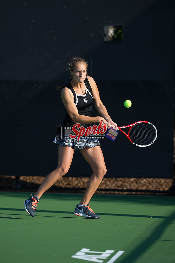 Kimmy Guerin of the Wake Forest Demon Deacons in action during the Wake Forest Invitational at the Wake Forest Tennis Center on October 3, 2014 in Winston-Salem, North Carolina.  (Brian Westerholt/Sports On Film)