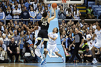 CHAPEL HILL, NC - MARCH 03: Ismael Massoud #25 of Wake Forest University shoots over Cole Anthony #2 of the University of North Carolina during a game between Wake Forest and North Carolina at Dean E. Smith Center on March 03, 2020 in Chapel Hill, North Carolina.