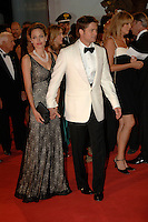 ANGELINA JOLIE &amp; BRAD PITT<br /> Premiere of &quot;The Assassination of Jesse James by the Coward Robert Ford&quot; at the 64th Venice Film Festival (La Biennale di Venezia), Venice, Italy.<br /> September 2nd, 2007<br /> full length long black lace layered dress maxi clutch bag pearl necklace couple cream white tuxedo jacket shirt suit black trousers bow tie  holding hands tattoos<br /> Ref: CAP/PL<br /> &copy;Phil Loftus/Capital Pictures /MediaPunch ***NORTH AND SOUTH AMERICAS ONLY***