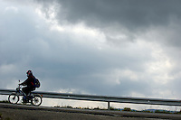 Moped on a road against a stormy sky, Saint-Paul-Trois-Châteaux, Drome, France.