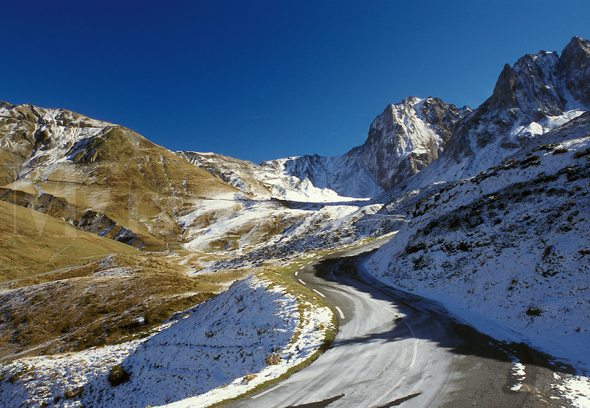 road, The Pyrenees, Col du Tourmalet, France, Midi-Pyrenees, Hautes-Pyrenees, Europe, A mountain road winds up through the jagged snow capped Pyrenees Mountains in Col-du-Tourmalet.