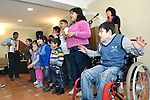 "THIS PHOTO IS AVAILABLE AS A PRINT OR FOR PERSONAL USE. CLICK ON ""ADD TO CART"" TO SEE PRICING OPTIONS.   A children's choir, including a boy in a wheel chair, sings during a worship service of the United Methodist Roma congregation in Jabuka, Serbia.."