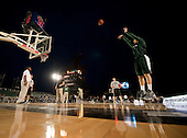 Michigan State University basketball player Alex Gauna shoots during a practice Thursday, November 10, 2011 in the basketball arena on the flight deck aboard Nimitz-class aircraft carrier USS Carl Vinson (CVN 70) in San Diego, California. Carl Vinson is hosting Michigan State University and the University of North Carolina for the inaugural Quicken Loans Carrier Classic basketball game on Veteran's Day, November 11.  United States President Barack Obama and first lady Michelle Obama are scheduled to attend the game..Mandatory Credit: James R. Evans - U.S. Navy via CNP