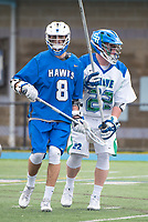 Danny Kelly,'17, stands guard as the Seahawks battle Roger Williams in Men's Lacrosse game action at Gaudet Field in Middletown.