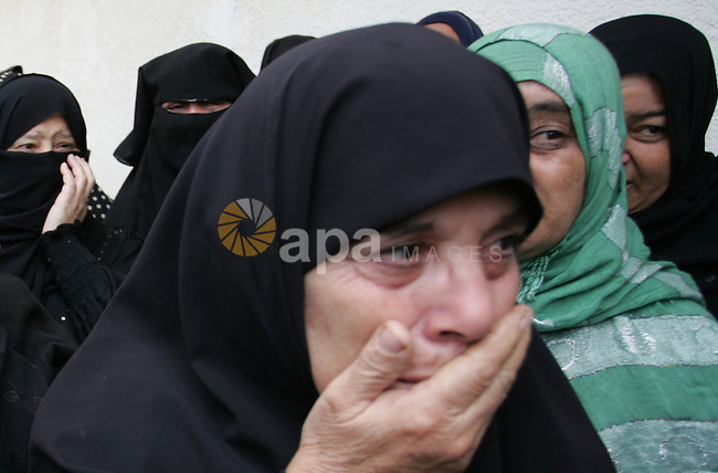 Palestinian women react during the funeral of DFLP militant Ahmed Jargon, killed in an Israeli strike on Sunday, in Rafah, southern Gaza Strip, Monday, Oct. 31, 2011. Deadly violence between Israel and Gaza militants flared over the weekend. In earlier exchanges of rockets and airstrikes, 10 militants and an Israeli civilian were killed. Photo by Abed Rahim Khatib