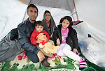 Javat and his wife Somaye, and their children Elyas, 4, and Mohadese, 9, who fled violence in Herat, Afghanistan, huddle together in a tent in a city park in Belgrade, Serbia. The park has filled with refugees from Syria, Afghanistan and other countries on their way to western Europe.